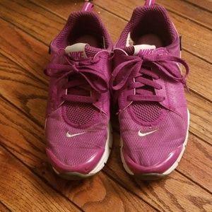 Purple Nike tennis shoes